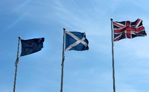 EU, Scottish and UK flags in the sky